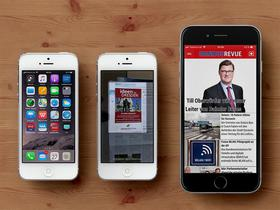 Drei Handys auf Holztisch